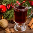 Cup of mulled wine, candle and christmas ball — Stock Photo