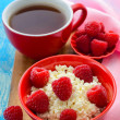 Fresh raspberries on curd and tea — Stock Photo #37344267