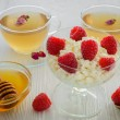 Stock Photo: Fresh raspberries on the curd and honey