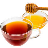 Tea with honey isolated on white — Stock Photo
