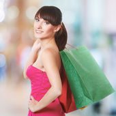 Young lovely woman with shopping bags — Stock Photo
