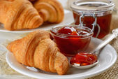 Breakfast with fresh croissants and jam — Stock Photo