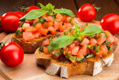 Bruschetta with tomatoes and basil — Stock Photo