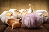 Garlic and a whole wooden table closeup — Stock Photo