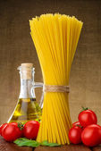Spaghetti with basil, tomato oil — Stock Photo