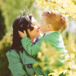 Young mother and her son spending time outdoor — Stock Photo