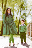 Portrait of fashionable boy and his mother — Stock Photo