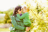 Happy mother holding baby son — Stock Photo