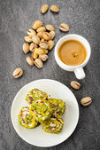 Pistachio turkish delight dessert and coffee — Stock Photo