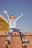 Little boy wearing roller skates — Stock Photo