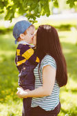 Loving mother kissing her son — Stock Photo