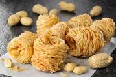 Closeup of birds nest baklava dessert with peanuts — Stock Photo