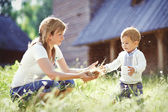 Loving mother in park playing with her son — Foto Stock