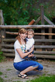 Loving mother and cute son at village — Stock Photo