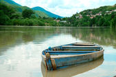 Boat in river on the picturesque landscape — Stock Photo