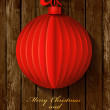 Red origami Christmas ball greeting card on wood background. — Stock Vector #35721105