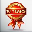 10 years anniversary golden label with ribbon. Vector illustration. — Vecteur
