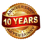 10 years anniversary golden label with ribbon — Stockvector
