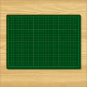 Green cutting mat — Stock Vector