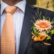 Stock Photo: Flower in lapel