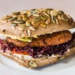 Vegetarian hamburger with bun with pumpkin seeds — Stock Photo #38290503