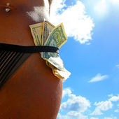 Girl and Dollars on the beach — Stock Photo