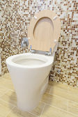 Toilet with wooden cover — Stock Photo