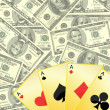 Image of playing cards on dollar background — Foto Stock