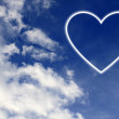 White heart in blue sky — Stock Photo