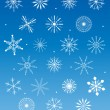 Snowflakes collection on blue background — Stock vektor
