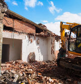 Dismantling of a house - demolition of a house — Stock Photo