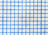 Magnifying sheet of white paper into squares — ストック写真