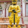 Stock Photo: Giant golden statue