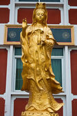 Golden statue of Guanyin — Stock Photo