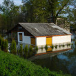 Flooded house on a river bank — ストック写真