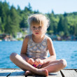 Little girl on the dock . — Stock Photo