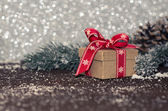 Gift box with Christmas decoration on wooden background. — Stock Photo