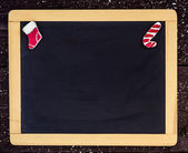 Christmas tree decorations border on wooden blackboard. — Stock Photo