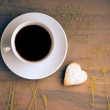 Stock Photo: Cup of teand cookies heart-shaped.