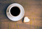 Cup of tea and cookies heart-shaped. — Stock Photo