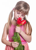 Little girl with flowers. — Stock Photo