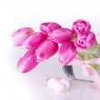 Pink tulips in glass vase with eggs . — Stock Photo #43523675
