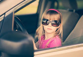 Little girl driving a car. — Stock Photo
