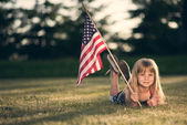Little girl with American flag. — Stock Photo