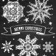 Vector set of chalk grunge snowflakes. — Stock Vector
