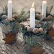 Christmas decoration: Burning candle in metal flower pot with cookies with fir branches — Stock Photo