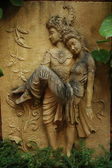 Lanna style art sculpture of two lovers in Northern Thailand — Stock Photo