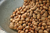 Brown chestnut beans roasting in a silver pan — Stock Photo