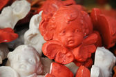 Little ceramic ornaments of cute cupids — Stock Photo