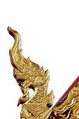 Golden naga Thai dragon ornament on temple roof isolated — Stock Photo